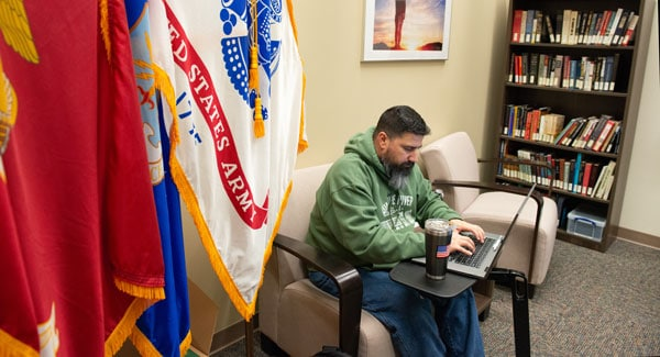 UTSA Student studying in military office